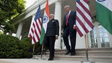 Президент США Дональд Трамп и премьер-министр Индии Нарендра Моди отправляются на пресс-конференцию в Белом доме в Вашингтоне. 26 июня 2017