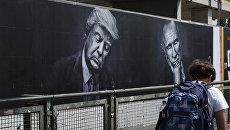 Портреты президента России Владимир Путина и президента США Дональда Трампа в Берлине. 27 июня 2017