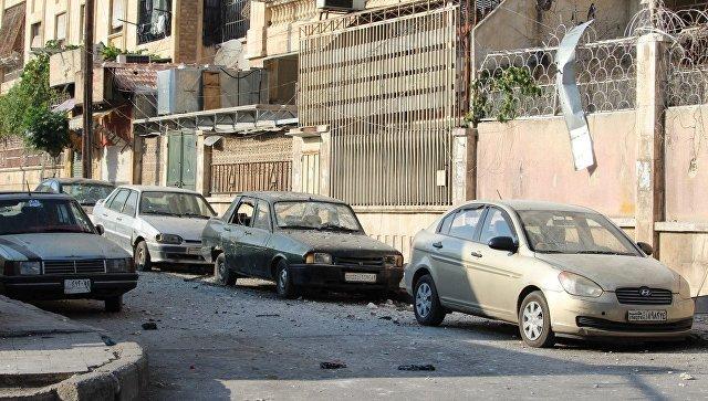 Квартал Аль-Акрамия в Алеппо после ракетного обстрела террористов. Архивное фото