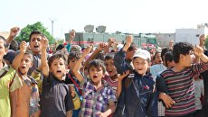 Дети в поселении Арран на севере-востоке Алеппо