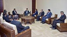 Встреча президента Сирии Башара Асада и замглавы МИД Ирана Хусйена Джабери Ансари. 30 августа 2017