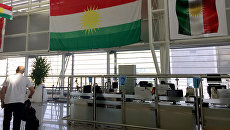 Флаги Иракского Курдистана аэропорту в Эрбиле. Архивное фото