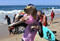 Ежегодный турнир по собачьему серфингу Surf City Surf Dog на пляже Хантингтон-Бич, Калифорния. 23 сентября 2017 года