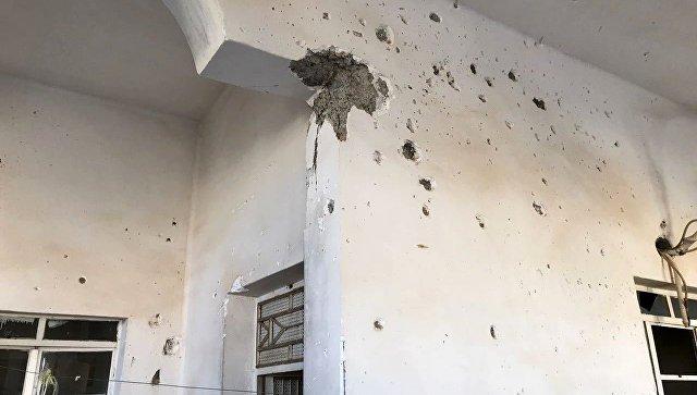Следы от пуль на стене жилого дома в Дейр-эз-Зоре. Архивное фото