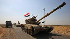 Иракские военные направляются к курдским позициям на южной окраине Киркука, Ирак