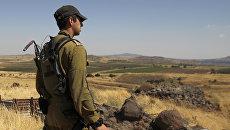 Израильский солдат возле израильско-сирийской границы. Архивное фото