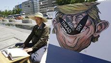 Участник акции протеста против развертывания системы ПВО THAAD в Южной Корее