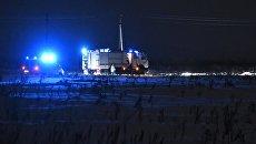 Сотрудники МЧС России в Раменском районе Московской области, где самолет Ан-148 Саратовских авиалиний рейса 703 Москва-Орск потерпел крушение 11 февраля 2018 года
