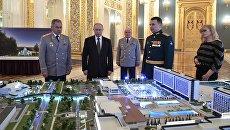 Президент РФ Владимир Путин и министр обороны РФ Сергей Шойгу на презентации военного инновационного технополиса Эра. 23 февраля 2018