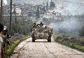Боец ССА стреляет из танка в Раджо, Сирия