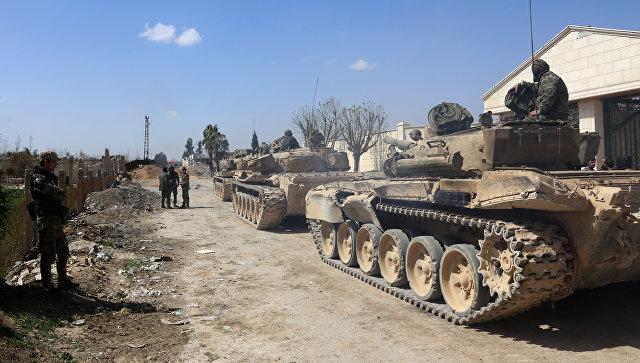 Военнослужащие сирийской армии в одном из освобожденных районов Восточной Гуты. 11 марта 2018