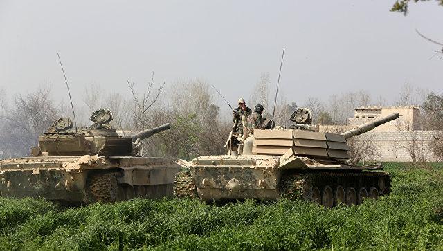 Военнослужащие сирийской армии в населенном пункте Афтрис в Восточной Гуте. 10 марта 2018
