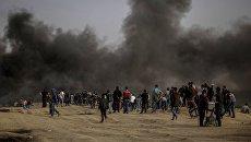 Столкновения палестинцев с израильскими военными на границе сектора Газа и Израиля. Архивное фото