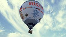 Керченский пролив освятили с гигантского аэростата Россия