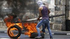 Столкновения палестинцев и израильских военных. Архивное фото