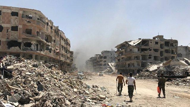 Разрушенные дома в освобожденном лагере палестинских беженцев Ярмук на юге Дамаска. Архивное фото