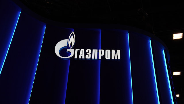 Логотип компании Газпром на Петербургском международном экономическом форуме. Архивное