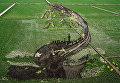 Изображение с надписью Удивительный Китай, сделанное в поле с использованием различных сортов риса