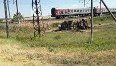Последствия ДТП с участием пассажирского поезда и грузовика в Азовском районе Ростовской области. 4 июня 2018
