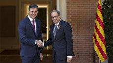 Премьер-министр Испании Педро Санчес и глава правительства Каталонии Ким Торра во время встречи в Мадриде. 9 июля 2018