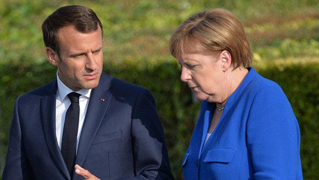 Эммануэль Макрон и Ангела Меркель на саммите НАТО в Брюсселе