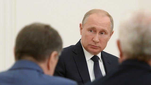 Президент РФ Владимир Путин во время встречи с президентом Молдавии Игорем Додоном. 14 июля 2018