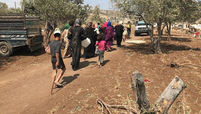 Мирные жители возвращаются в свои дом в провинции Дераа. Архивное
