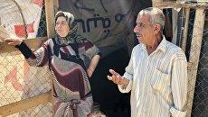 Сирийские беженцы в палаточном лагере в центральном Бекаа в поселении Каб Эльяс. Архивное фото