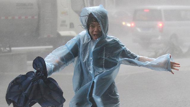 Женщина на улице в КНР. 16 сентября 2018