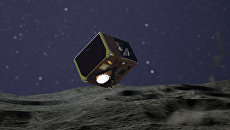 Так художник представил себе ровер MASCOT, опускающийся на поверхность астероида