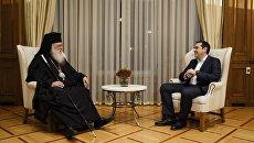 Премьер-министр Греции Алексис Ципрас и архиепископ Афинский и всей Греции Иероним во время встречи. 6 ноября 2018