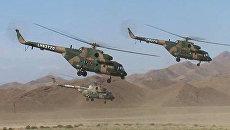 Базу террористов атаковали с вертолетов, окружили танками и взяли штурмом