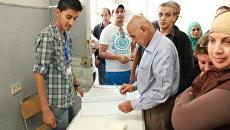 На избирательном участке в Тунисе