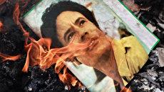Каддафи, его сын и экс-глава разведки Ливии объявлены в международный розыск