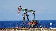 Нефтяные скважины близ района Бока де Харуко