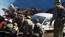Поиск живых будет продолжаться, пока есть надежда – японские спасатели