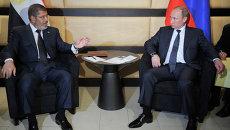 Президент РФ Владимир Путин (справа) и президент Египта Мохаммед Мурси