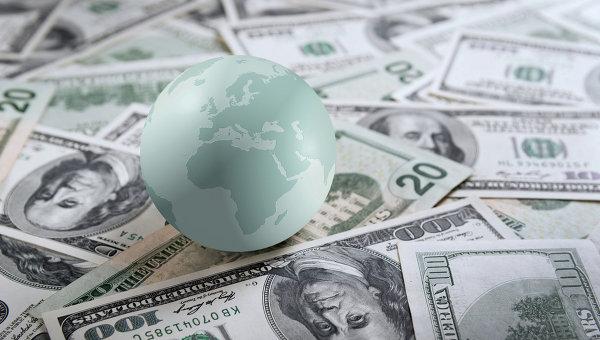Глобус на банкнотах американских долларов