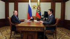 В.Путин и А.Новак. Архивное фото