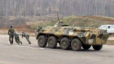 Бойцы Факела тащили БТР весом 13 тонн по полигону на Интерполитехе-2013