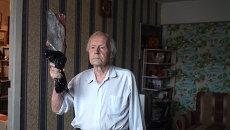 101-летний новосибирский факелоносец тренируется с рыбой вместо факела