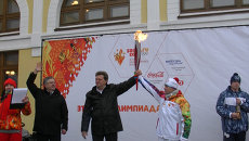 Олимпийский огонь прибыл в Томск и отправился по его улицам