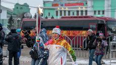 Олимпийская чемпионка по биатлону Анна Богалий во время эстафеты олимпийского огня в Новосибирске, архивное фото